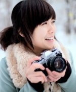Beautiful girl play photography in winter
